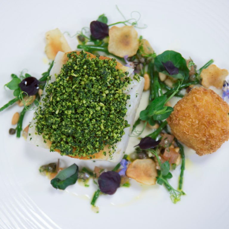 Roasted cod with pine nut crumb, Jerusalem artichokes, brandade and sauce vierge